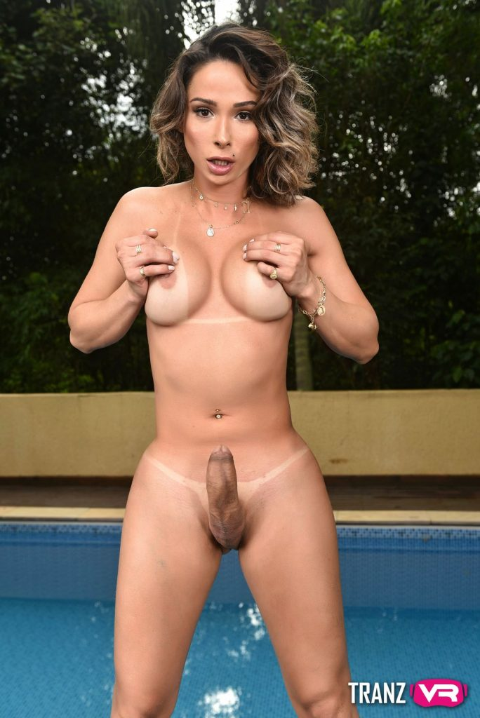 beautiful shemale holding natural large breasts